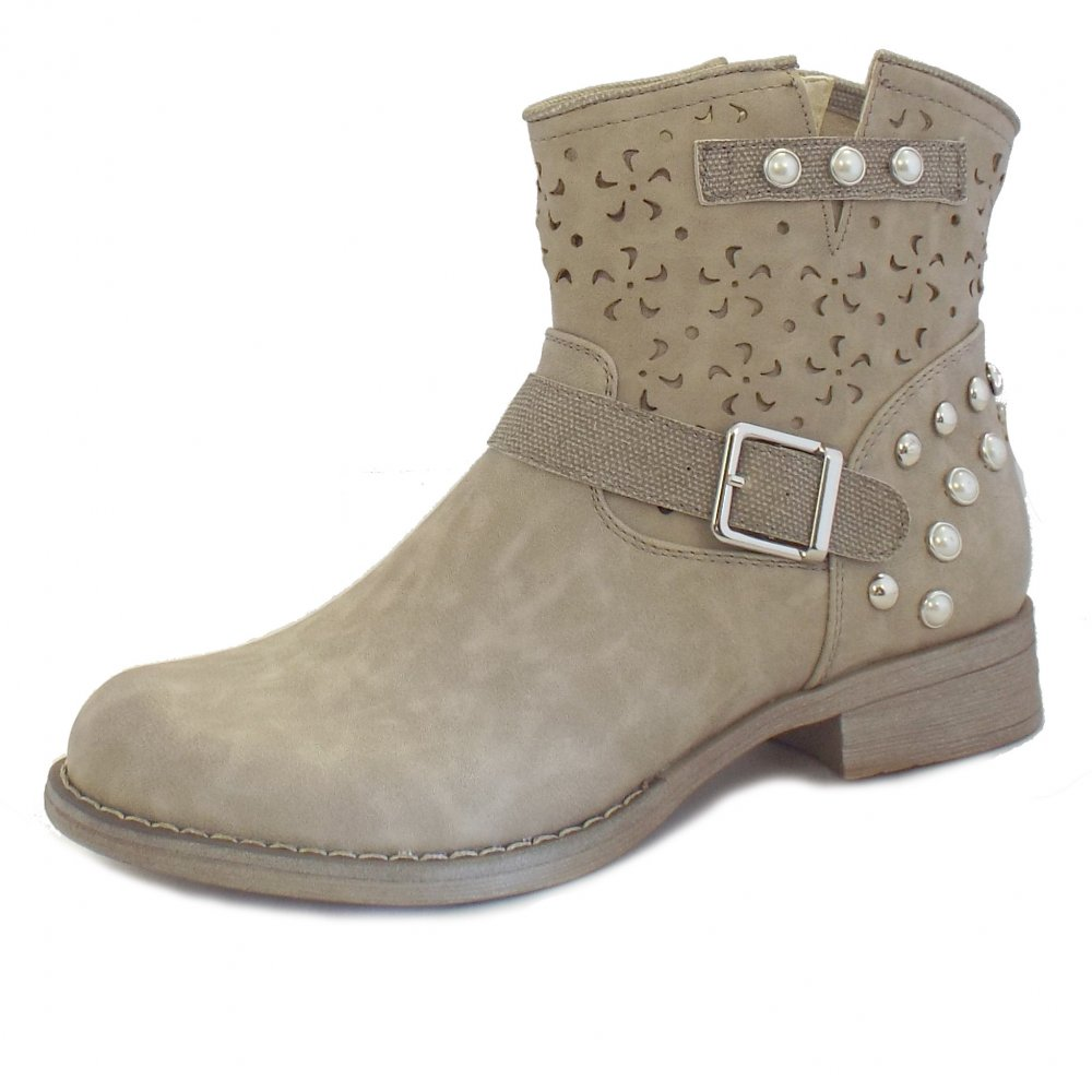 Womens Rialto Sonny ankle boots with a faux leather upper, decorative strappy detail, zipper side clsorue, smooth fabric lining, cushioned foot bed and a durable man made outsole with a .
